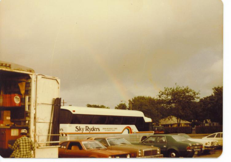 1982 photo of a double rainbow behind the tour bus.