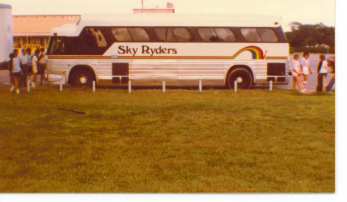 1982 tour bus on the road.